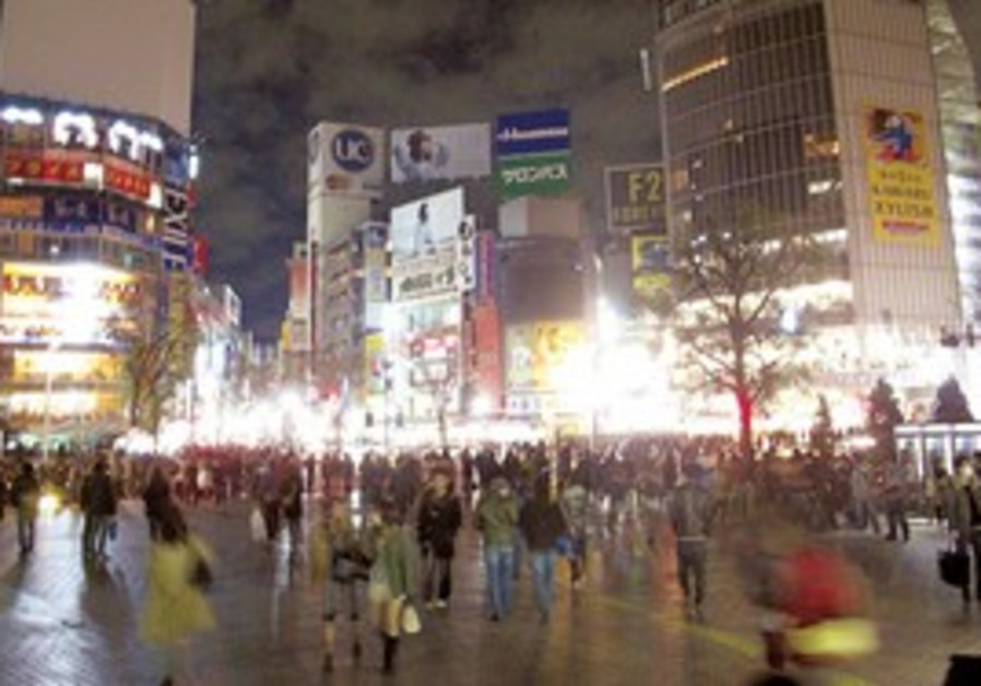 LIFE GOES on as usual in Tokyo's Hachiko Square.