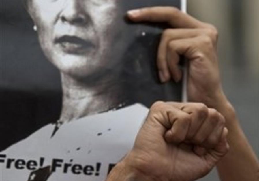 Myanmar student demonstrators hold photographs of