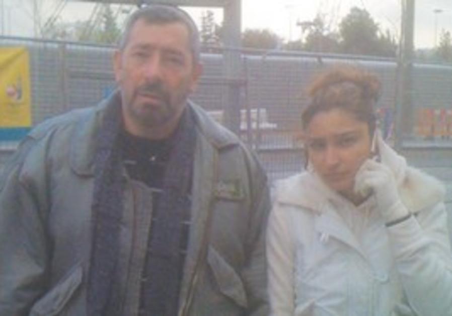 SHIREL SHALLEM, 26, standing near her father, Eliy
