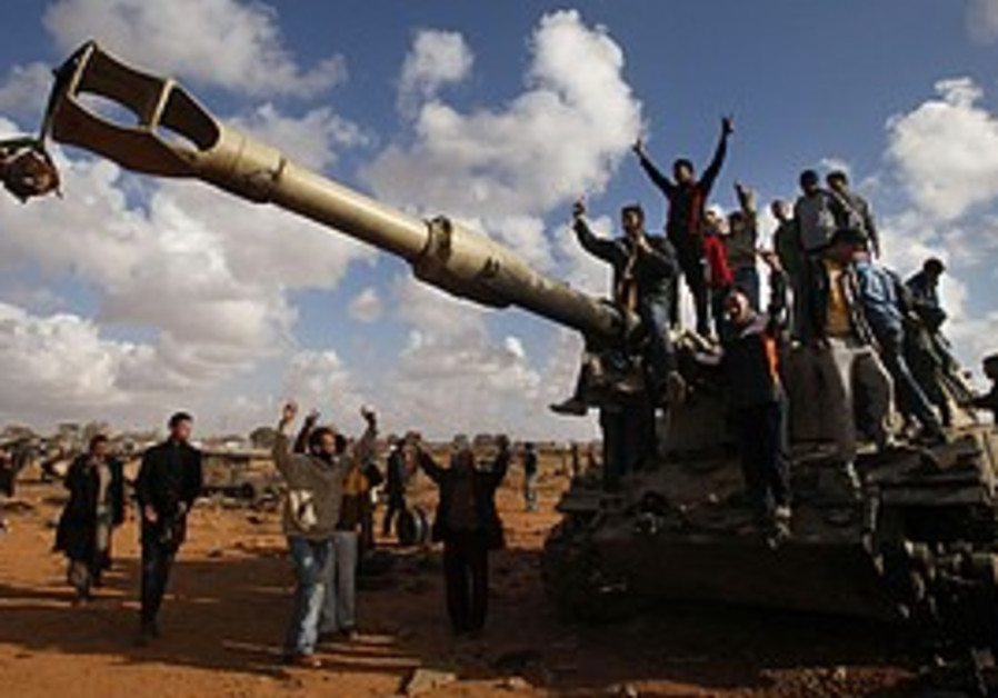 Libyans standing on a tank