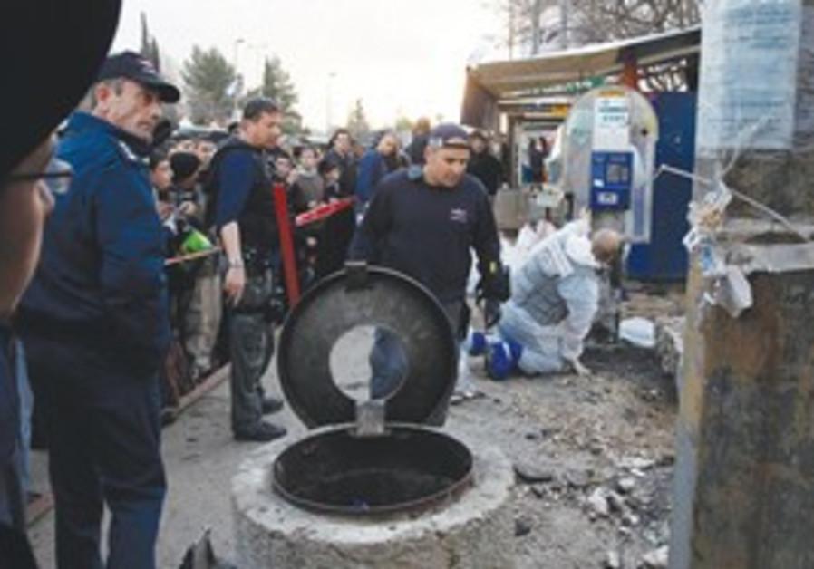 Bomb squad officers at J'lem bomb site