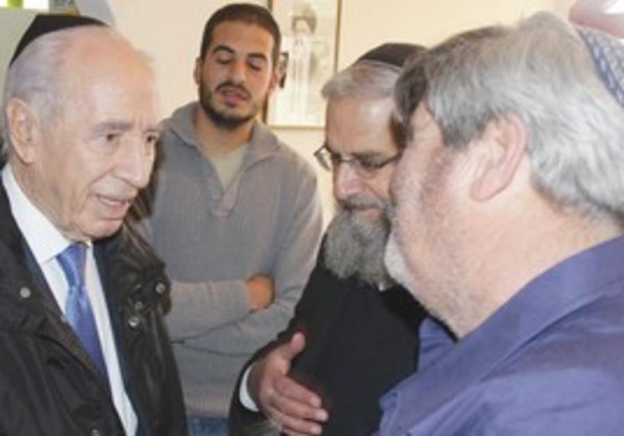 Shimon Peres visits Fogel, Ben-Yishai  families.