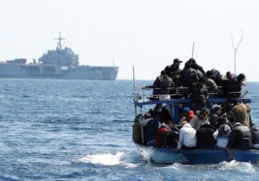 People feeling Tunisia approach an Italian ship.