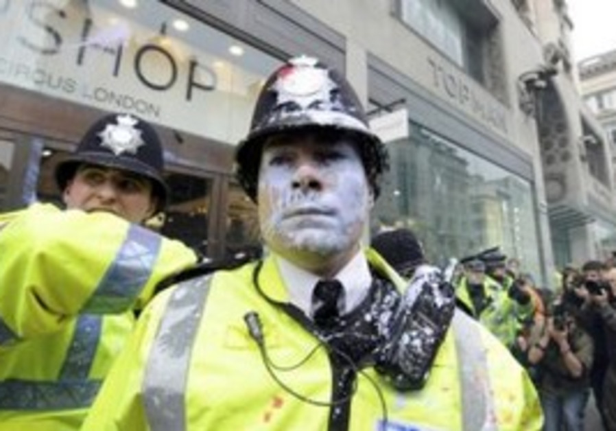 Policeman is splashed with paint in Oxford Street