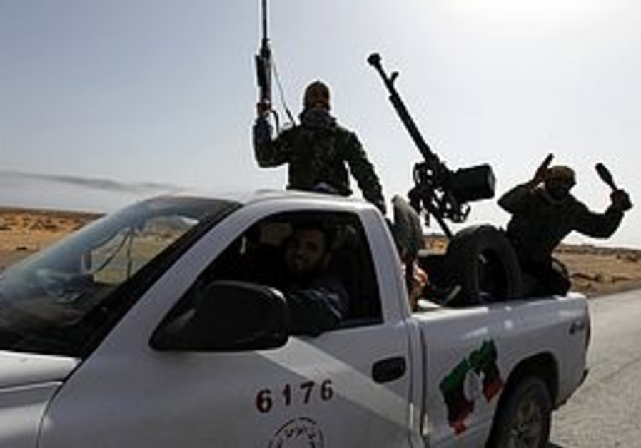 Libyan rebels outside Sirte