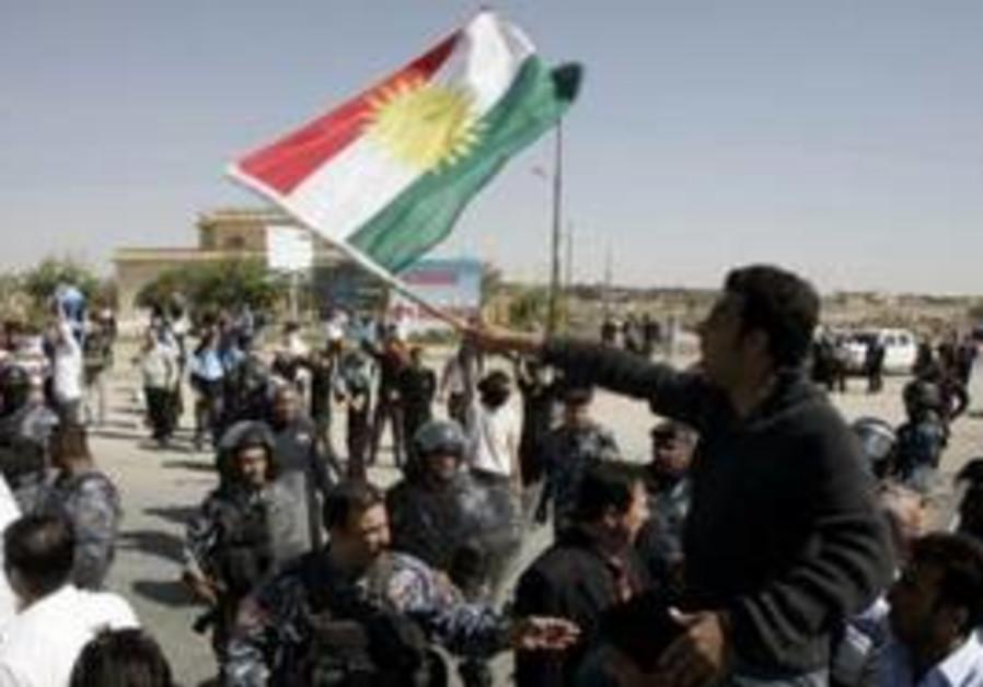 Riot police disperse protesters in Iraq