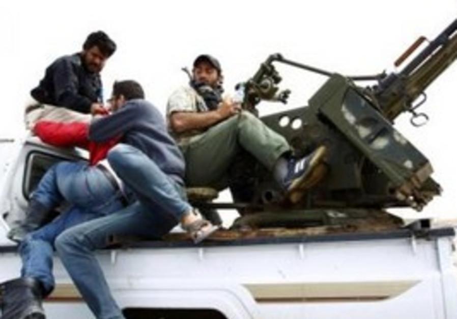 Libyan rebels with anti-aircraft gun