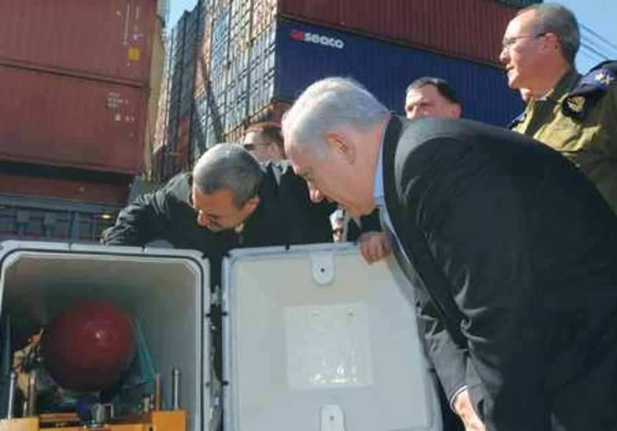 Ehud Barak and Benjamin Netanyahu examine missile