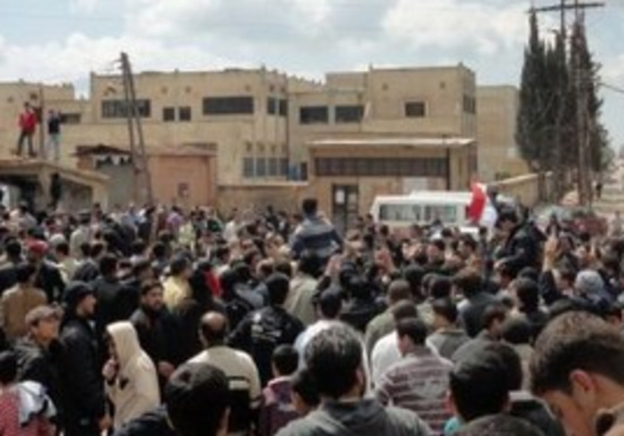 """Syrians shout """"freedom"""" during a protest"""