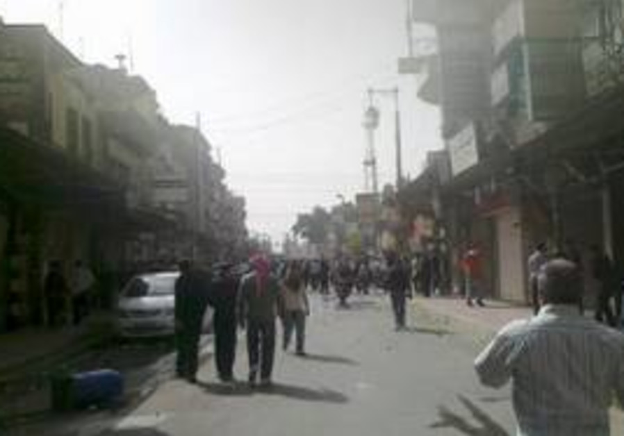 Anti-government protesters in Damascus, Syria