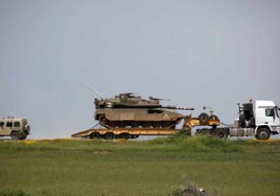 An IDF Merkava tank being transported near Gaza.