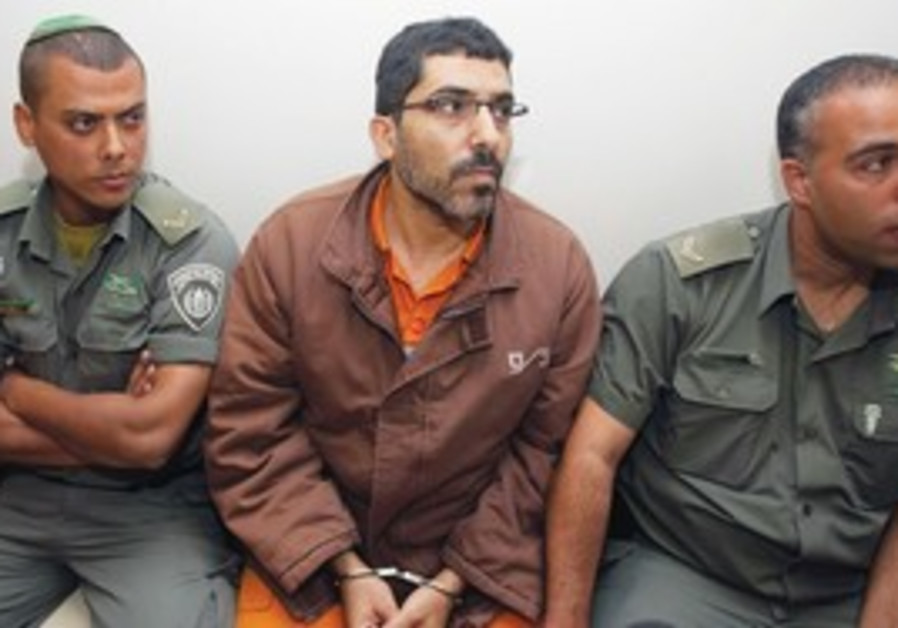 Palestinian engineer Dirar Abu Sis in court