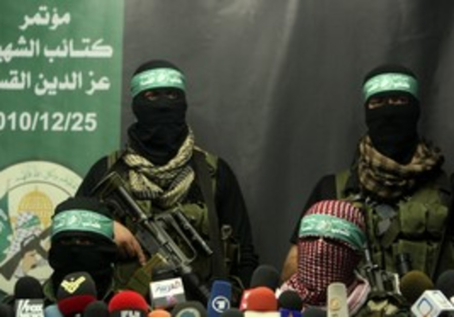 Hamas terrorists at a press conference.