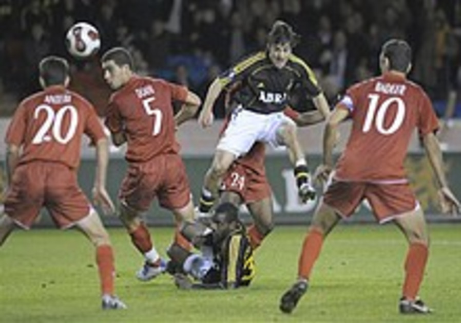 Soccer: Hapoel TA through, Netanya crashes out