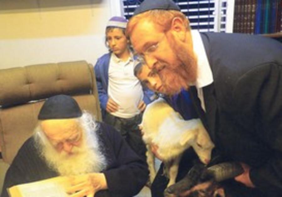 RABBI CHAIM KANIEVSKY (left) and Rabbi Yehuda Glic