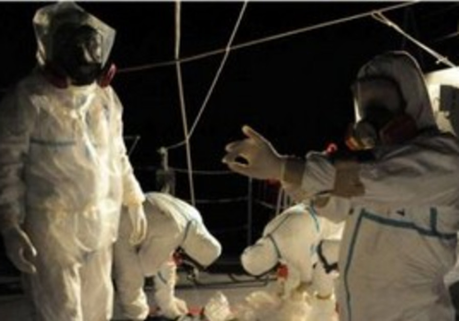 Workers in protective gear near Fukushima plant