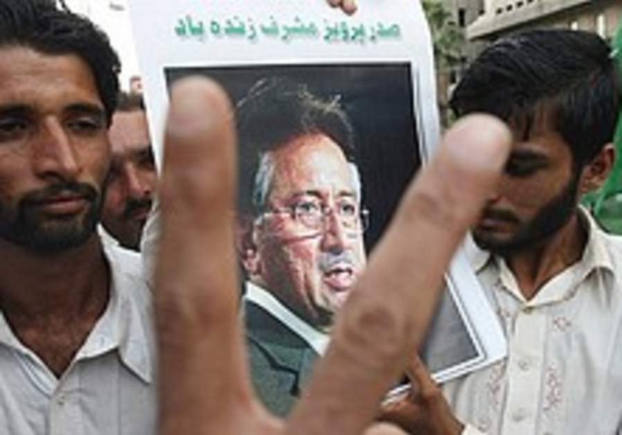 Court clears Musharraf's continued rule; election date set