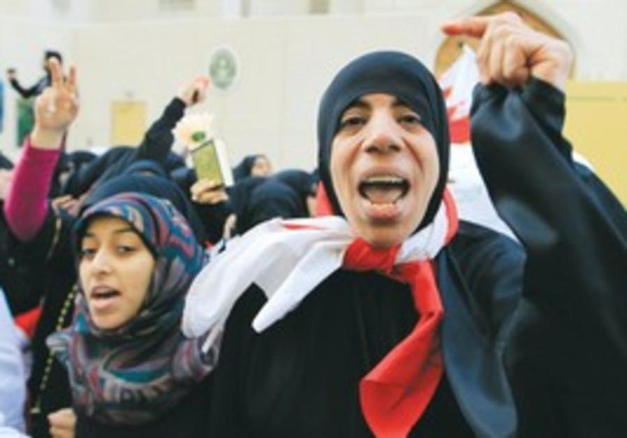 Anti-gov't protesters near Saudi embassy, Bahrain.
