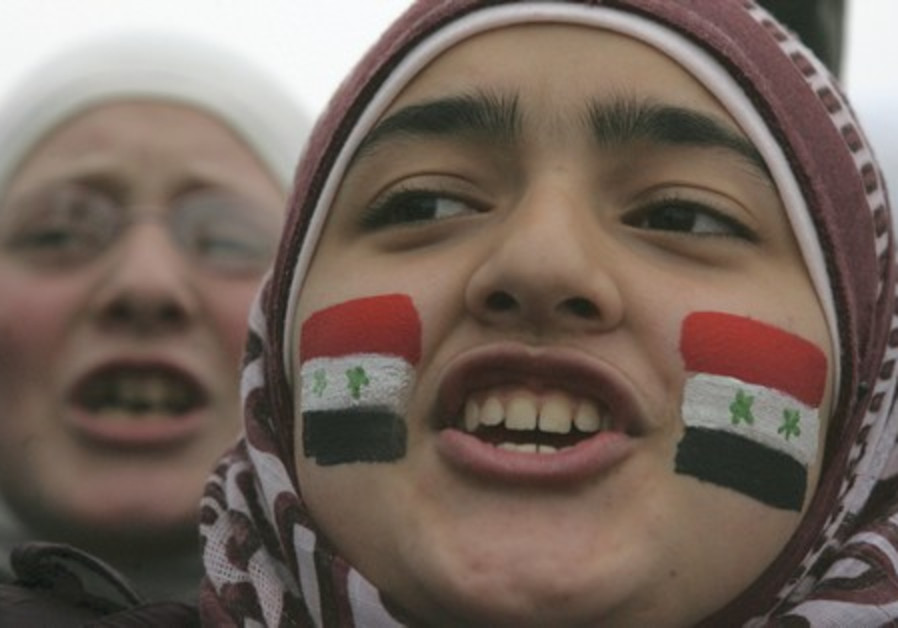 Syrians living in Jordan shout slogans.