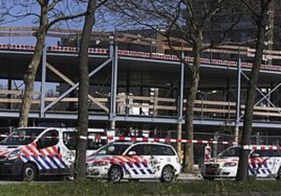 Dutch police cordon off the scene of a shooting