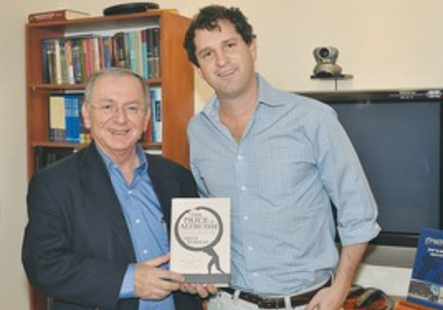 Oren Harman presents book to Bar-Ilan president