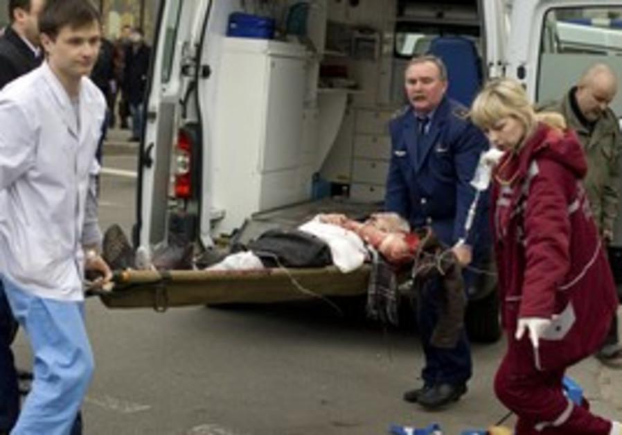 People carry a blast victim in Minsk.