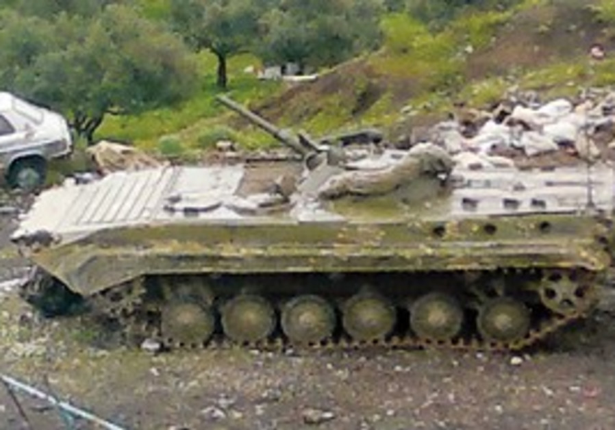 A tank keeps watch in Banias, Syria, Monday.