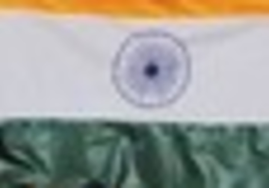 A man holds up an Indian flag.