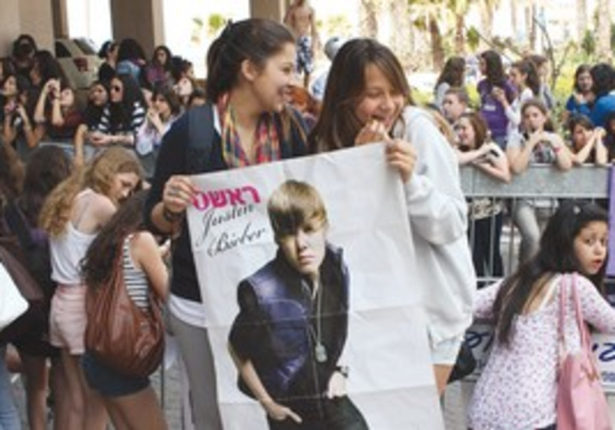 Justin Bieber fans wait for the young hearthrob.