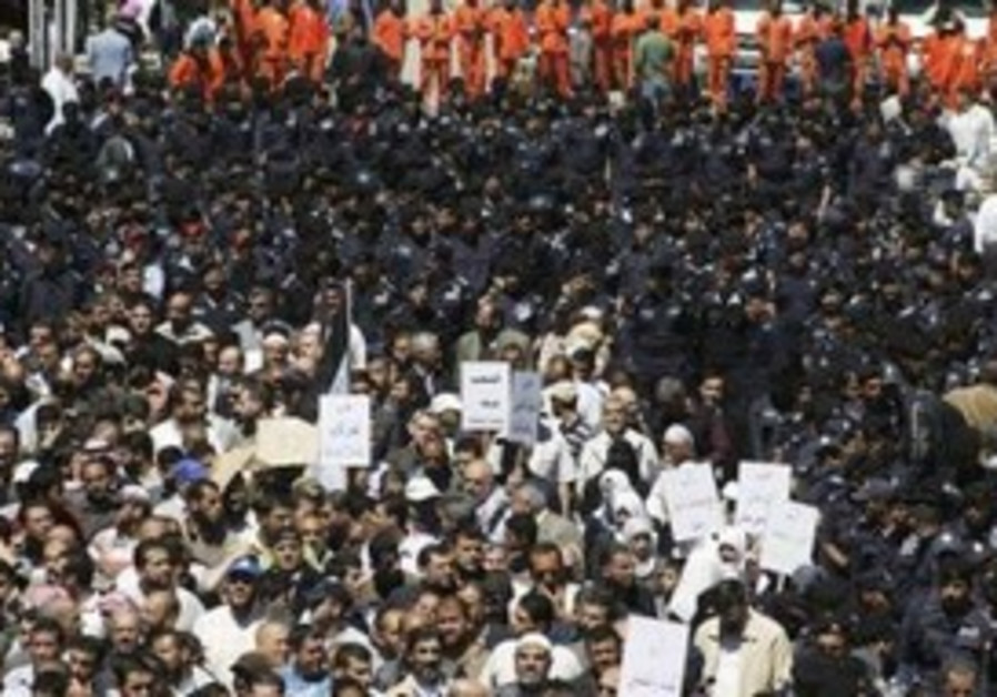 Policemen form a line separating protesters