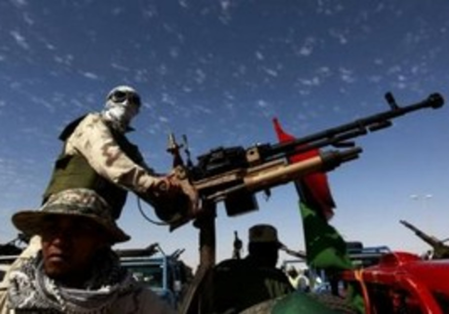 Libyan rebel with anti-aircraft gun