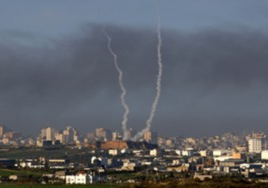 Smoke trails after rockets are fired in Gaza