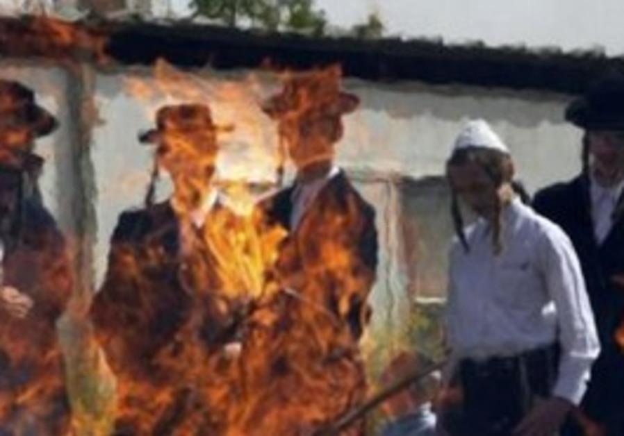 Haredim burn leaven in Mea Shearim