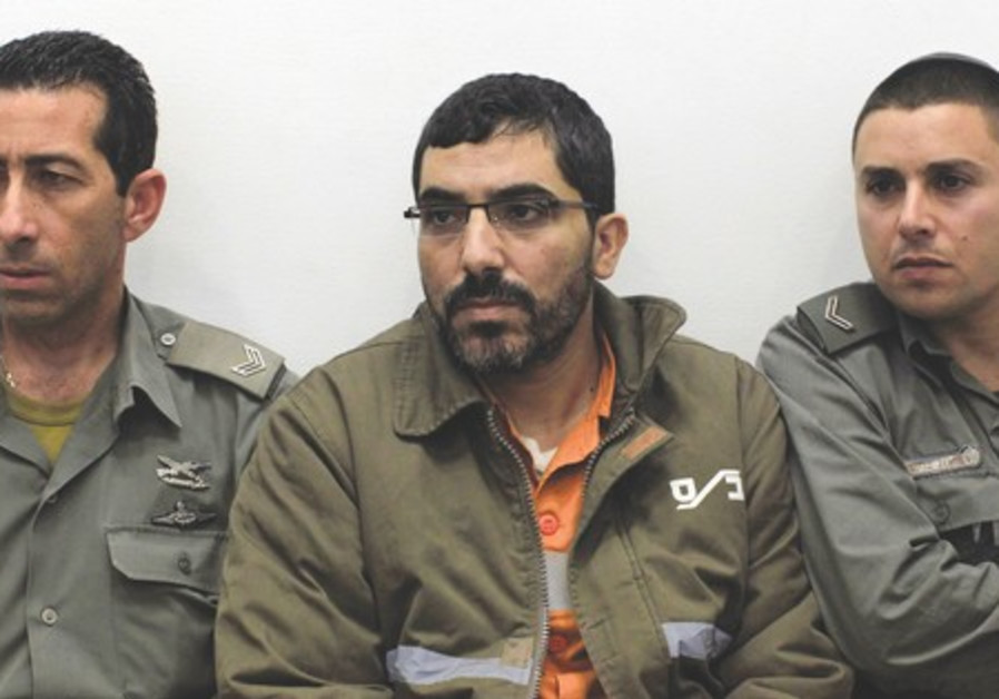 Dirar Abusisi, flanked by guards, in Beersheba.