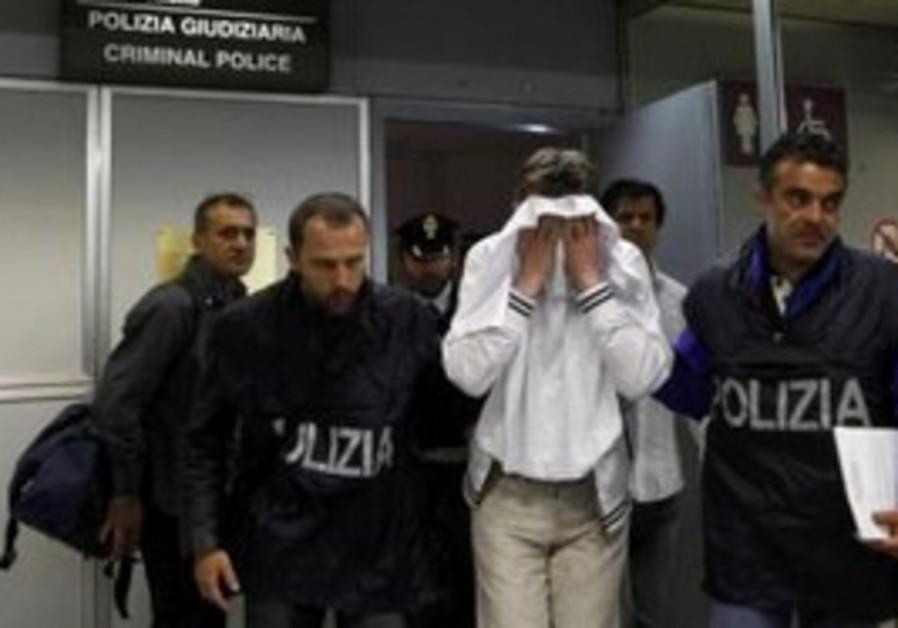 Would-be hijacker of Alitalia flight in police cus