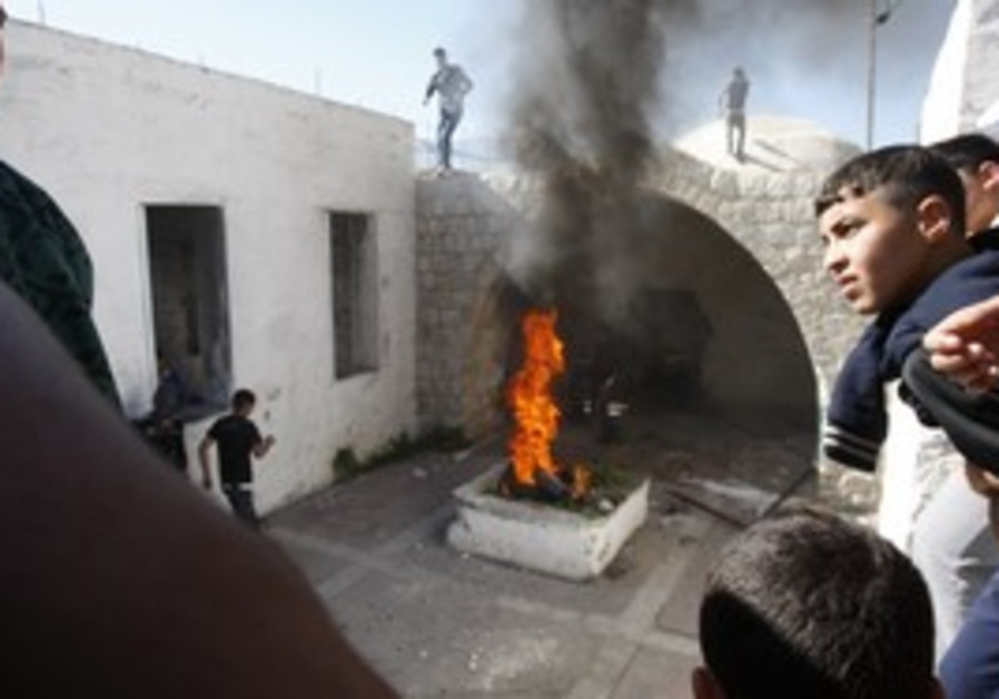 Palestinian rioters set fire in Joseph's Tomb.