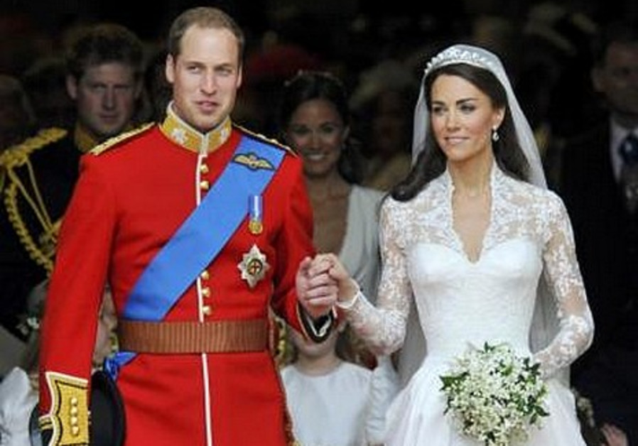 Britain's Prince William, Kate Middleton walk out.