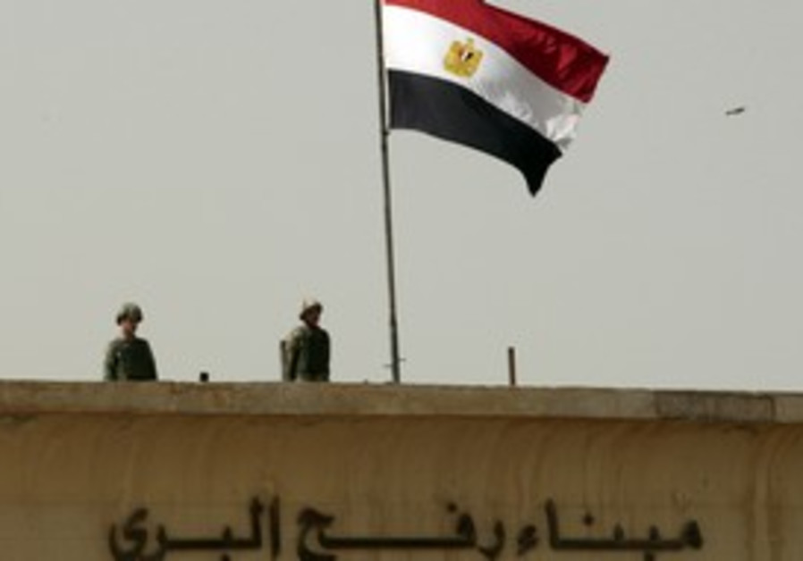 Egyptian forcesguard the Rafah crossing in Gaza.