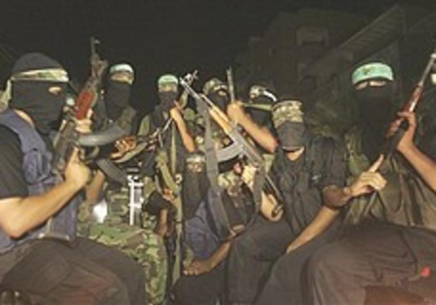 Hamas gunmen at a march in Rafah