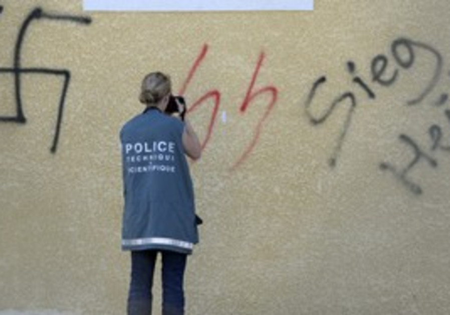 French police photograph neo-Nazi graffiti