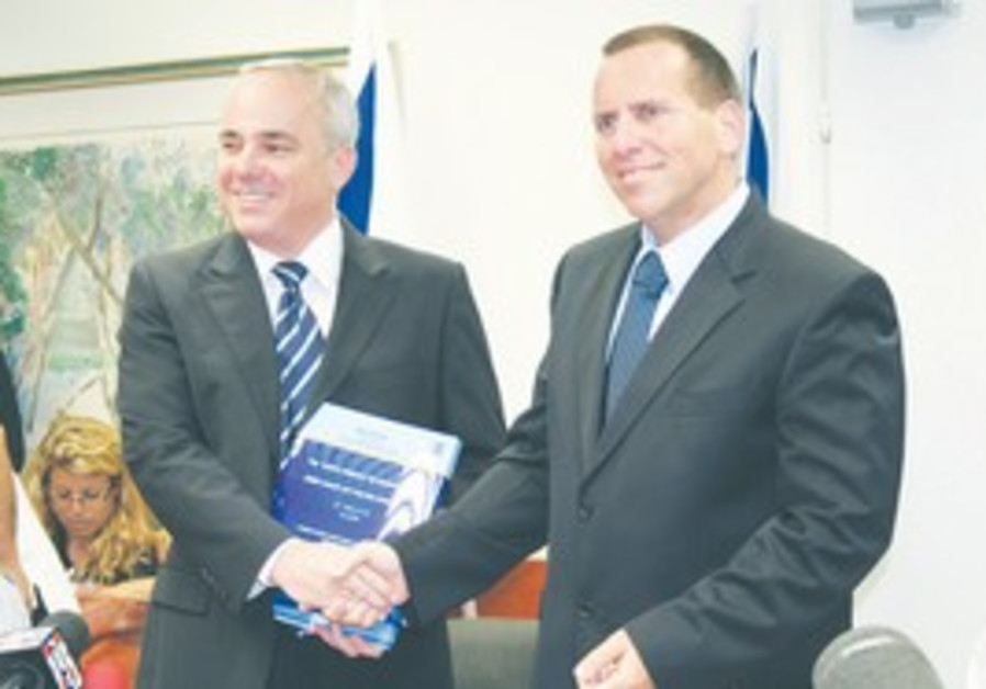 Finance Minister Yuval Steinitz and Ilan Levin