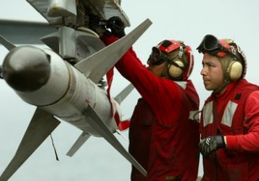 US aviation men load a HARM air-to-surface missile