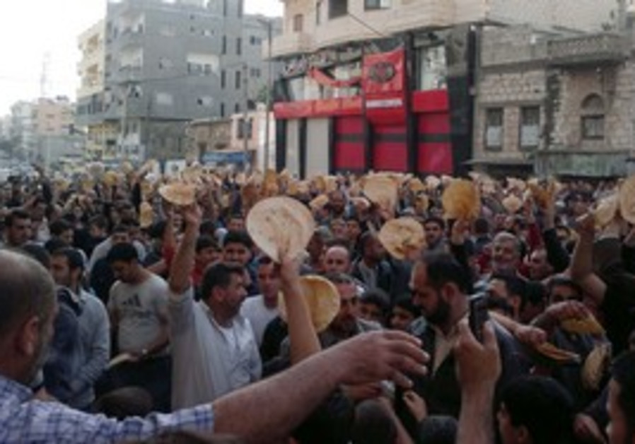 Protesters with pieces of bread in Banias, Tuesday