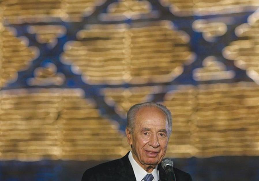 President Shimon Peres lights Elem Flag of Hope
