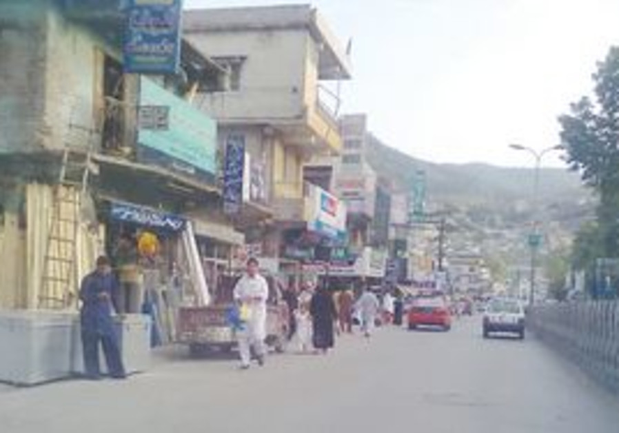 A STREET scene in Abbottabad Thursday.