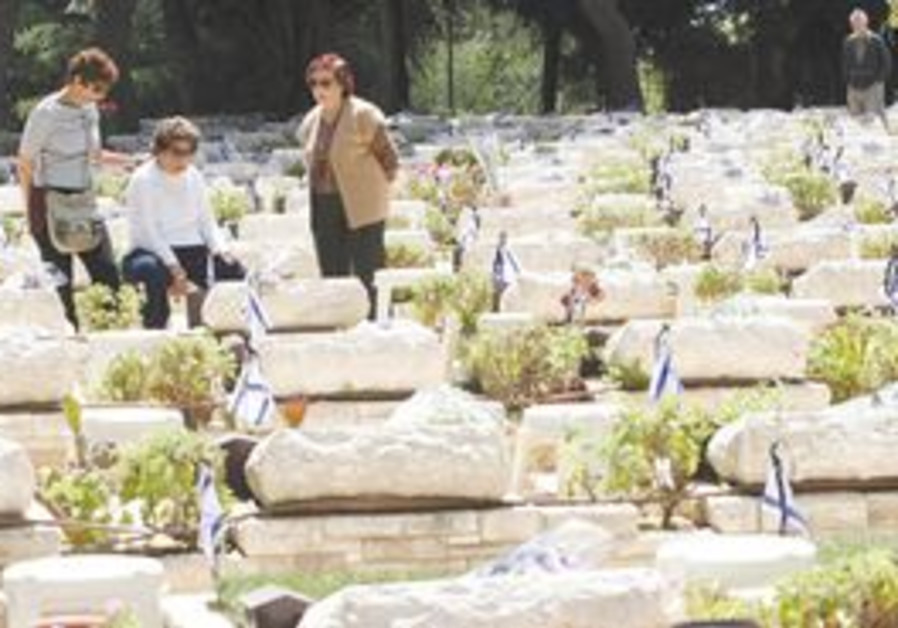 Soldiers' graves are visited at a cemetery