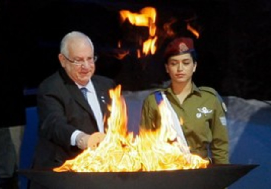 Rivlin lighting the Independence Torch.