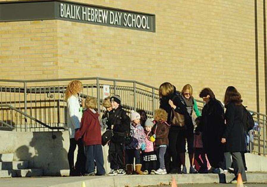 Parents take students to Bialik school