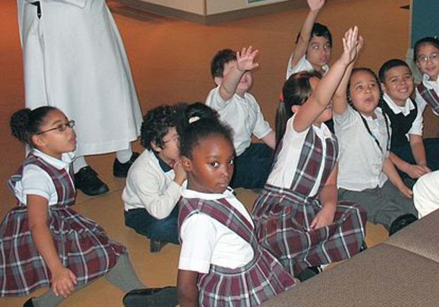 Students at the museum raise hands