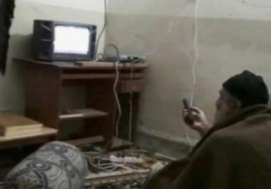 Osama bin Laden is shown watching himself on TV